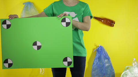 Unrecognizable woman holding chroma key poster with tracking points. Environment Live Action