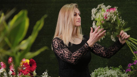 Florist holds flowers in her hands. Beautiful flowers Live Action