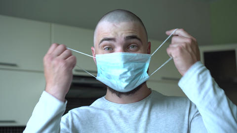 The Bald Man in the Protective Mask Finds out that the Pandemic has ended, the Live Action