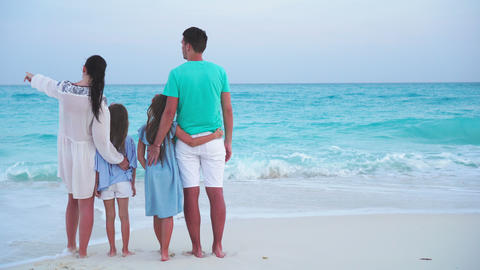 Young family on vacation on the beach. Family travel concept Live Action