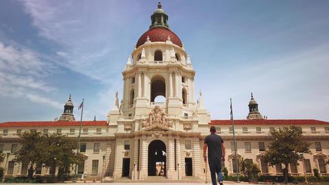 Man walking towards Pasadena City Hall Building, Mediterranean Spanish building Live Action