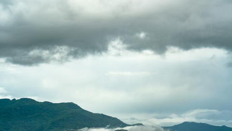 Cloudy storm sky motion over mountain profile timelapse,weather climate Live Action