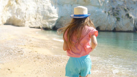 Active little girl at beach having a lot of fun Live Action