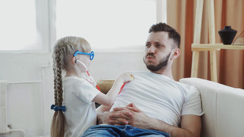Daughter and father playing having fun together girl imagines herself to be Live Action