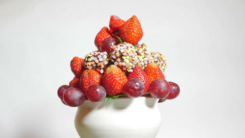 Delicious fruit bouquet spinning on a white background Footage