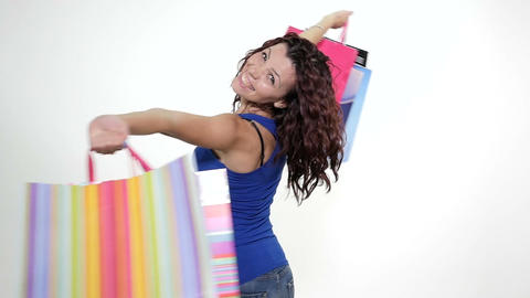 Young attractive woman is excited about shopping - slow motion Footage