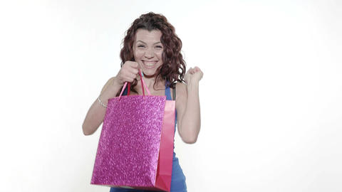 4k - Young attractive woman walks in, looks curiously in a gift bag, and walks o Footage