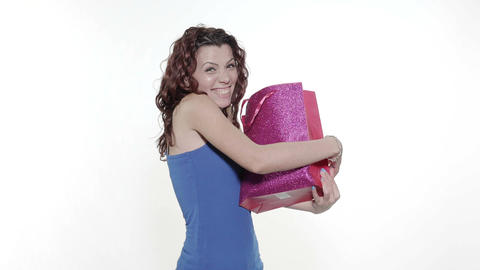 4k - Young attractive woman catches a gift bag falling from above Footage