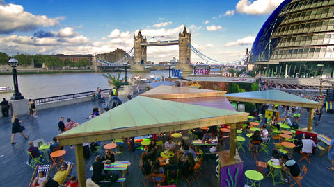 London, UK. Circa August 2016. Open restaurant next to Tower Bridge and City hal Footage