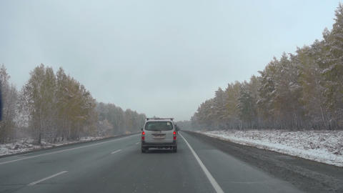 Early snow in October in Siberia, commuter highway Footage