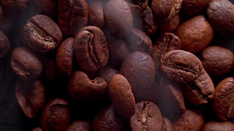 coffee beans are roasting, smoke comes from coffee beans Live Action