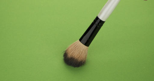 Vertical movement of the brush for makeup on a green background Live Action