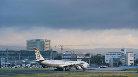 Etihad airbus 340 taxiing at early morning Live Action