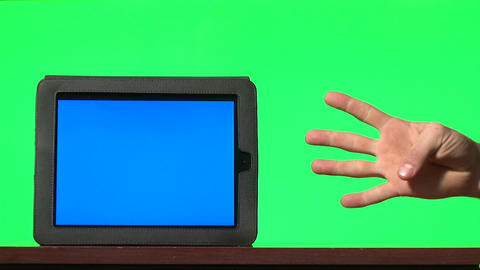 Man presenting digital tablet with a blue screen and gesturing: pointing, countd Footage