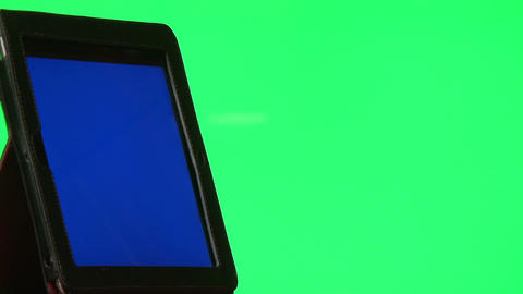 Man using digital tablet with a blue screen to add your own custom content Footage