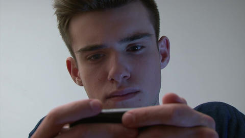 Teenage boy using smartphone Footage