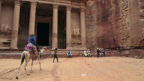Woman tourist riding on his camel in Petra Jordan Footage