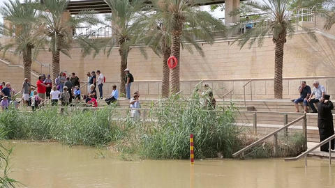 Tourists near the Sacred water of the River Jordan Footage