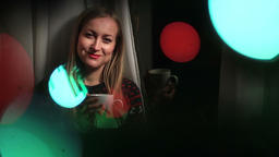 Attractive woman in bokeh circles of Xmas lights Footage