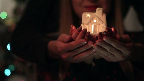 Male and female hands holding luminous house Footage