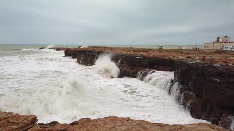 Wave crushing dangerous rocks coast Live Action