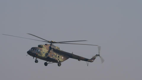Russian made troops transport helicopter Mil Mi 17 Hip with mimetic camouflage Live Action
