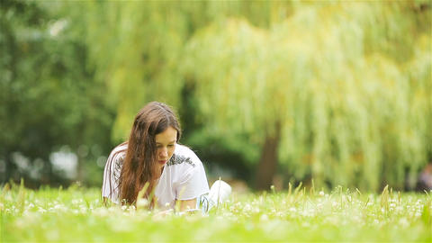 Relaxed young woman reading book Live Action