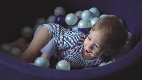 Childhood, games, toy, development, entertainment concept - little two-year-old Live Action