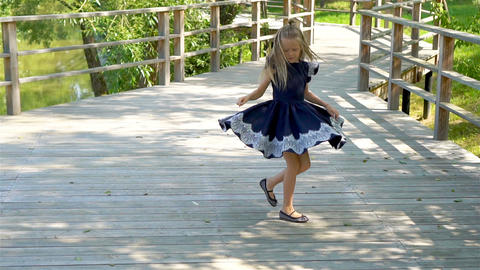 Adorable little school girl have fun outdoor. Back to school. Slow motion video Live Action