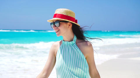Beautiful woman on summer holidays smiling happy on white beach. Happy girl Live Action