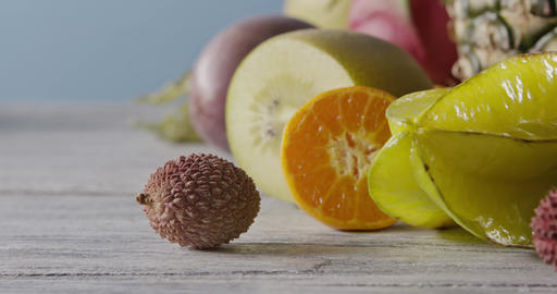 Fresh natural organic exotic fruits on a wooden gray background. Concept of Live Action
