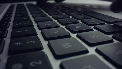 Person using laptop computer. Man hands typing on black keyboard of laptop Live Action