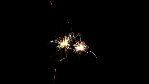 Two sparklers burning from top to bottom on black blackground HD PNG 25FPS Footage