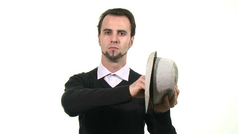 Magician pulling a business card out of a hat Footage