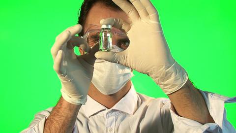 Scientist analyzing clear liquid form bottle Footage