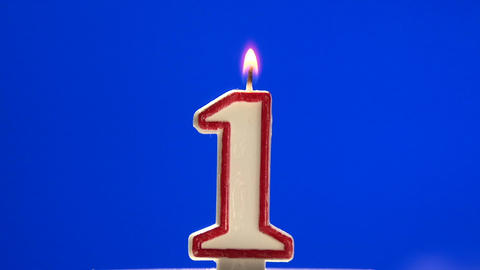 Number 1 - one birthday candle burning - blow out at the end Footage