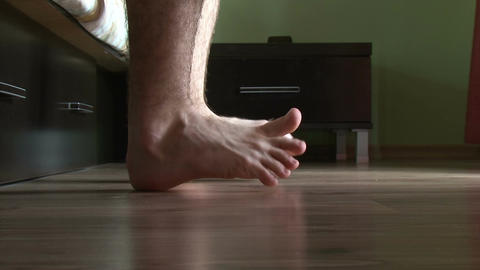 Male feet getting out of bed Live Action