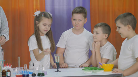 Chemical experiments for children. Fun experiments for children. Woman adds Live Action