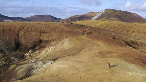 Amazing aerial drone shot of people riding on a path in Iceland Live Action