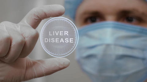 Doctor looks at hologram with Liver Disease Live Action