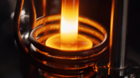 Metal parts heated with electric induction heating during production process Live Action
