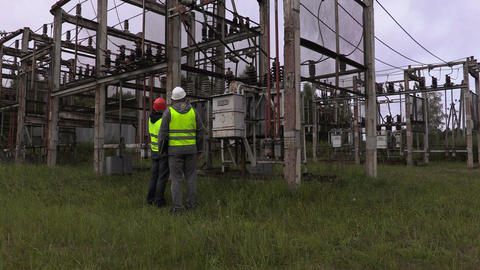Electrical engineers take inspection the technical condition of the substation Footage