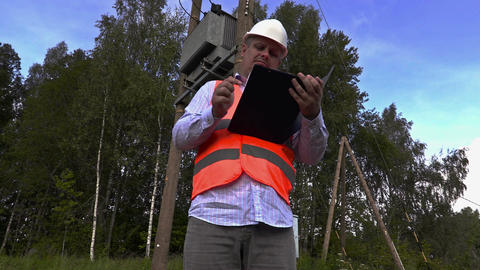 Electrician take transformer technical inspection Footage