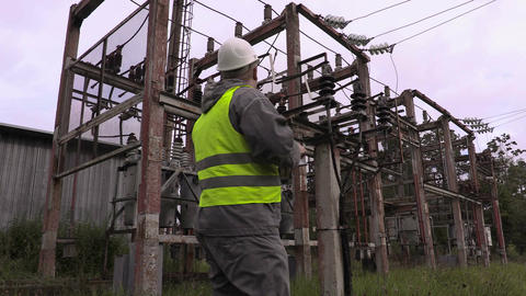 Electrician take pictures in electrical substation Live Action