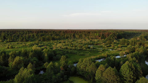 flying over beautiful country side landscape woods and rivers, on sunset, aerial Live Action