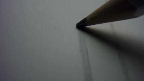 Macro of pencil writing flat line. Unknown person drawing line on paper Live Action