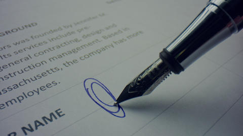 Unknown person signing document with pen. Worker using nibbed fountain pen Live Action