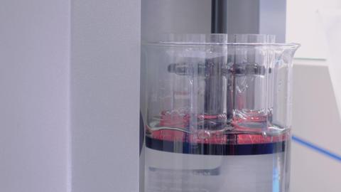 Laboratory equipment concept - automatic tablet disintegration tester: close up Live Action