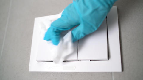 Surface sanitizing wipes of home surfaces, wall button switches wiping paper Live Action