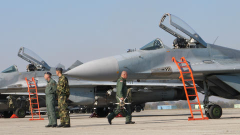 Military Fighter Jet Pilot and Specialist in front of MiG 29 Combat Aircraft Live Action